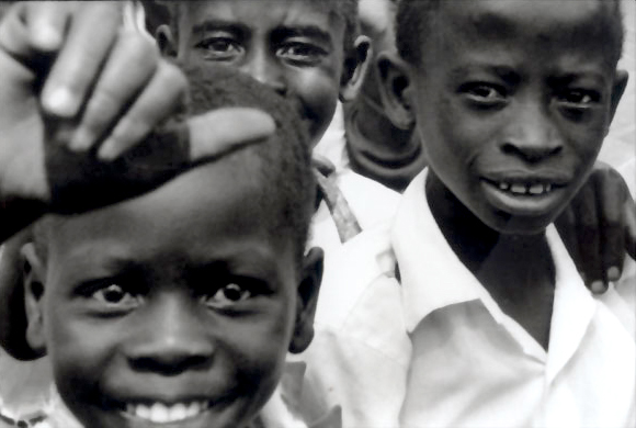 school boys smiling as they leave classes for the day in village in Africa